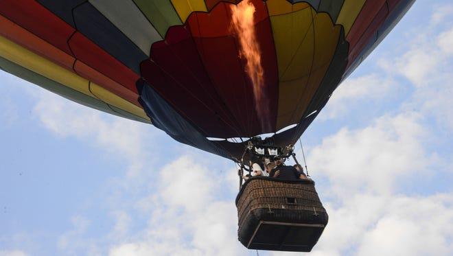 Balloons take off from Otsiningo Park.