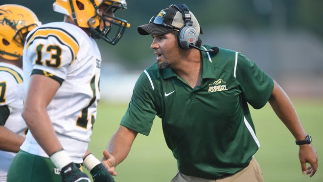 Capt. Shreve head coach Bryant Sepulvado congratulates his team after scoring in a past game.