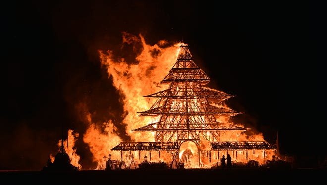 9/4/168:25:56 PM Flames outline the skeleton of the elaborate Temple at Burning Man as it was burned to the ground on Sunday evening.
