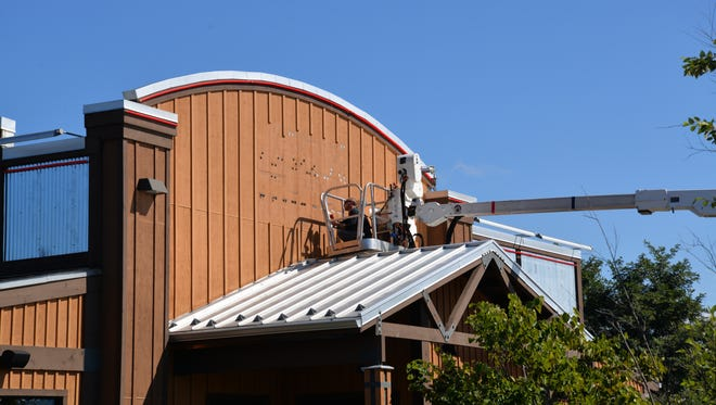 The large Logan's Roadhouse sign being removed on Tuesday, Sept. 27, 2016. The business closed this week.