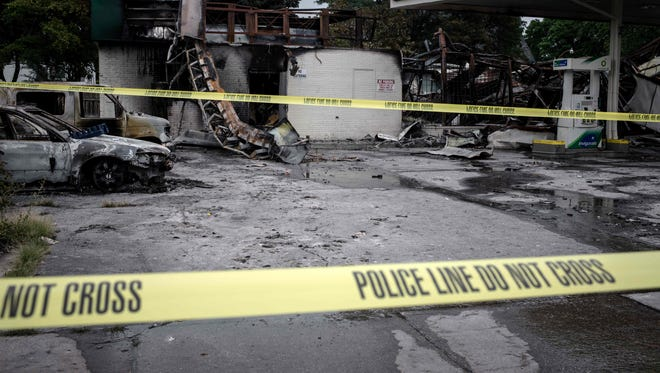 A gas station stands in ruins in Milwaukee, Wisconsin, August 15, 2016 after police in the Midwestern city faced off with protesters August 13 and 14 following the death of 23-year-old Sylville Smith, who officials say was armed.