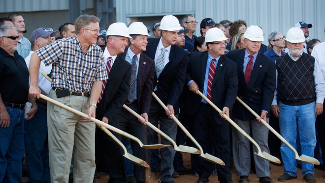 State economic development Commissioner Randy Boyd, third from left, helps break ground for an expansion of auto parts company E&E Manufacturing Of Tennessee Wednesday, Oct. 19, 2016, in Athens, Tenn.
