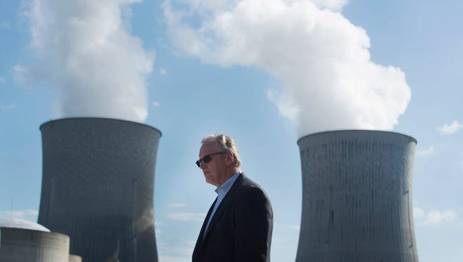 "TVA President and CEO Bill Johnson pauses in front of the cooling towers before announcing the new Unit 2 reactor has entered commercial operation Wednesday, Oct. 19, 2016, at the Watts Bar Nuclear Plant. ""Watts Bar Unit 2 is a key part of our commitment to produce cleaner energy without sacrificing the reliability and low cost that draws both industry and residents to our area,"" said Johnson."