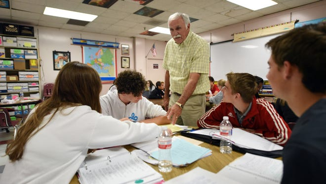 AP history teacher Si Thompson helps his 10th-grade students work on a class assignment at Petal High School. Oak Grove, Purvis and Petal high schools scored among the top 20 schools in the state in the 2015-16 accountability rankings.