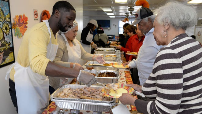 Volunteers serve Thanksgiving dinner to seniors at the Vincente K. Tibbs Senior Citizen Building in Englewood in 2015 during an event organized by the Bergen County Relief Center.