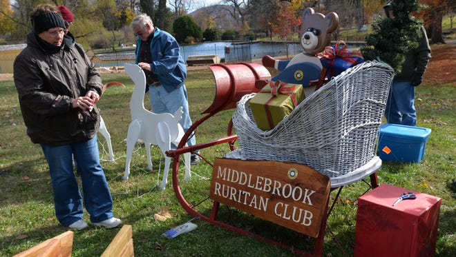 Members of the Middlebrook Ruritan Club set up a display for the Celebration of Holiday Lights in Staunton's Gypsy Hill Park on Sunday, Nov. 20, 2016.