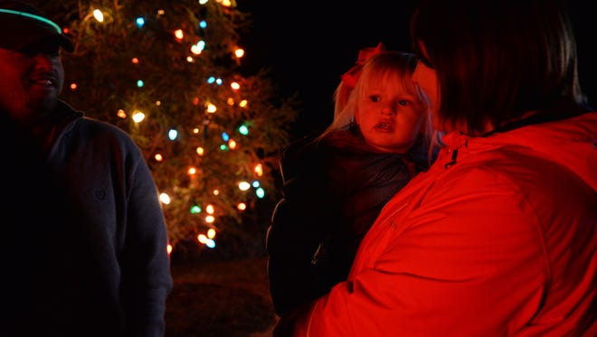 Layla Grimm with her mother Courtney and father Doug during the Middlebrook Christmas tree lighting on Sunday, Nov. 27, 2016.
