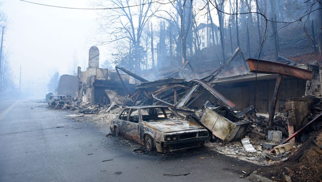 Out of control wild fires have burned multiple business and vehicles like these along Cherokee Orchard Rd in Gatlinburg causing a mandatory evacuation Tuesday, Nov. 29, 2016.