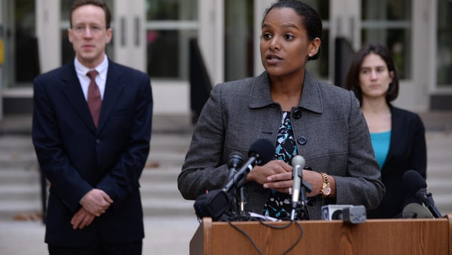 'Jessica Clarke, attorney for the Stein campaign leading recount efforts in Michigan, speaks during a press conference on Wednesday, Nov. 30, 2016 at the Pedestrian Plaza in front of the Michigan Bureau of Elections in Lansing. The Dr. Jill Stein campaign filled a petition for a manual hand recount of all votes cast in Michigan.'
