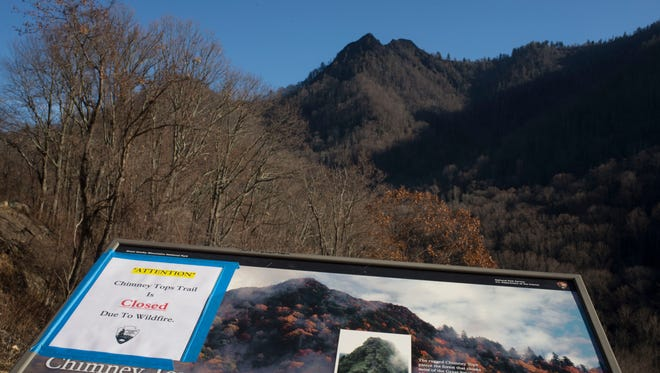 The wildfire-scarred Chimney Tops is pictured Friday, Dec. 2, 2016, in the Great Smoky Mountains National Park. Officials say the fire that has killed 13 people and destroyed more than 700 structures started here on Nov, 23. The fire is human caused and under investigation.