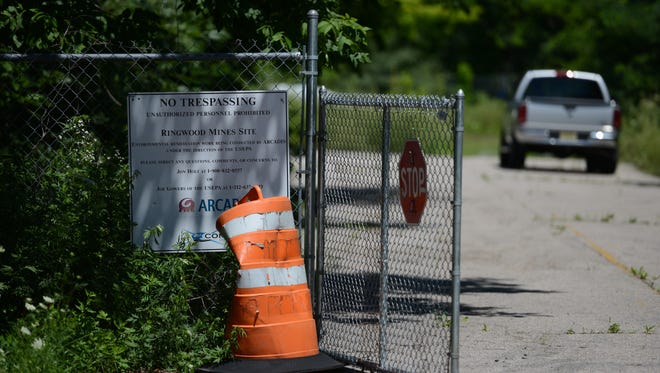 A gate to the Ford Superfund site on Peters Mine Road remained open in this July 20 photo. The site is the subject of a Dec. 6 EPA meeting at 7 p.m. in Ringwood's Ryerson Middle School.