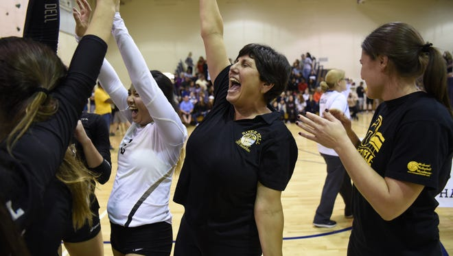 Dianne Furusawa (center), shown celebrating River Dell's Bergen County championship with her players, is The Record 2016 girls volleyball Coach of the Year.