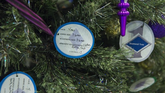 Paper ornaments adorn Holloman's first sergeant Diamond Tree inside the Base Exchange at Holloman Air Force Base, N.M. on Nov. 29, 2016. The Diamond Tree program offers assistance to low income and junior enlisted families who are not able to afford Christmas gifts for their children.
