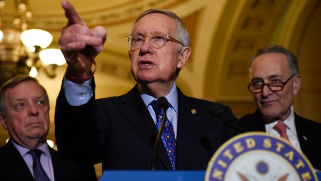 Senate Minority Leader Harry Reid of Nev., flanked by Senate Minority Whip Richard Durbin of Ill., left, and Senate Minority Leader-elect Charles Schumer of N.Y., answers questions from the media after the Democratic policy luncheon on Capitol Hill in Washington, Tuesday, Dec. 6, 2016. (AP Photo/Sait Serkan Gurbuz)