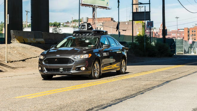 Uber will open a development this spring in Wixom. This is a self-driving Ford Fusion that Uber has tested in Pittsburgh and Phoenix.
