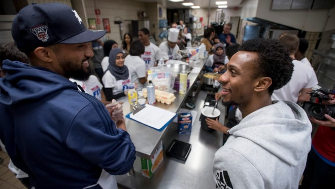 Detroit Pistons point guards Darrun Hilliard, left, and Ish Smith chat while participating in the second annual 'Ready-Set-Cook' competition.