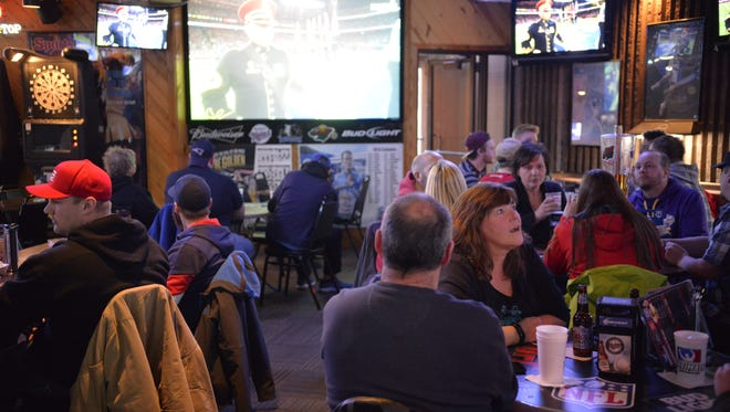 Football fans watch Super Bowl LI at the Ultimate Sport Bar & Grill. A number of fans said they plan to go to Minneapolis in 2018 for Super Bowl LII.