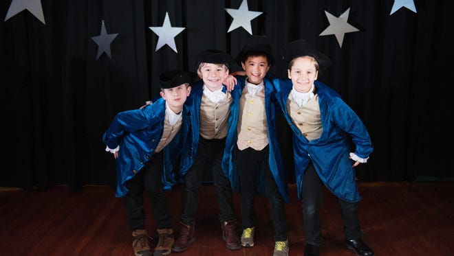 Itamar Kaplun, Henry Foster, Tyler Suwankosai, and Jack Smith, from left, perform Feb. 3 at the annual Wyoming School talent show.