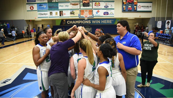 UWF coach Stephanie Yelton (center) and her team became the school's first to win the GSC regular season title and will play in NCAA tournament for third time in four years.