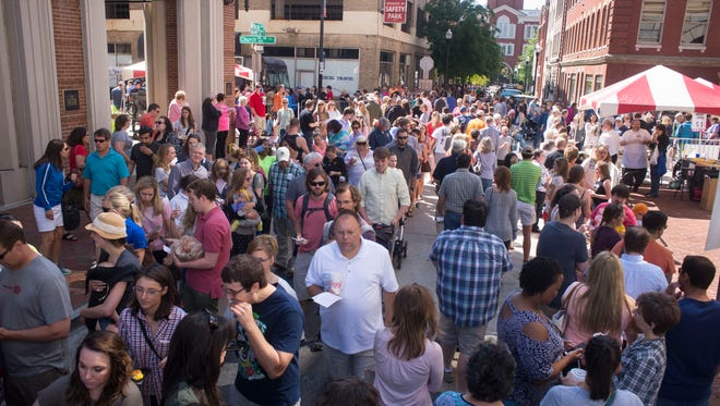 Biscuit lovers crowd Biscuit Boulevard during the International Biscuit Festival last year in downtown Knoxville. (News Sentinel)
