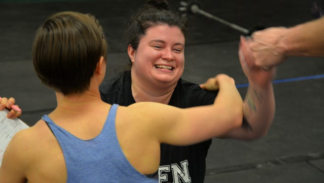 Reporter Laura Peters smiles and hugs coach Becca Paxton after finishing her first CrossFit Open on Friday, March 24, 2017.