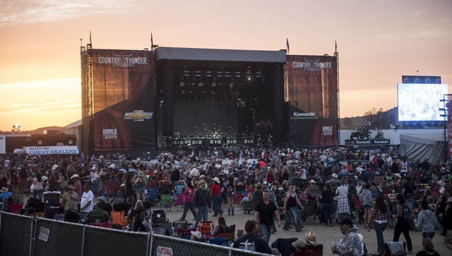 Spectators wait in between shows on the last night of the Country Thunder music festival in Florence on Sunday, April 9, 2017.