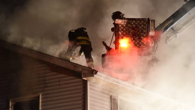 Fire fighters and other responders battle an early morning house fire on Schooley's Mountain Road in the Long Valley section of Washington. April 14, 2017.