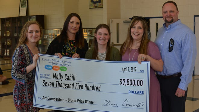 Independence High School student Molly Cahill, middle, won $7,500 in an international art competition.