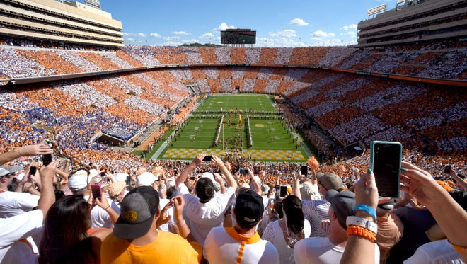 The University of Tennessee football team takes the field as the Pride of the Southland marching band performs a pregame show and fans checker Neyland Stadium orange and white for the Florida game on Saturday, Sept. 24, 2016. (MICHAEL PATRICK/NEWS SENTINEL)
