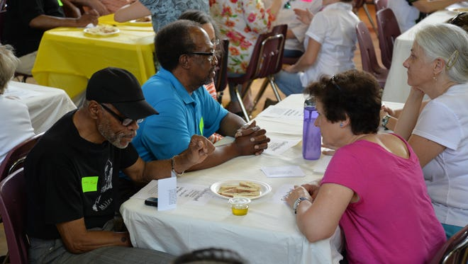 People gather at tables at the Breaking Bread event on Sunday, April 30, 2017. The event was to start conversations with the public on bridging the gap of diversity in the community.