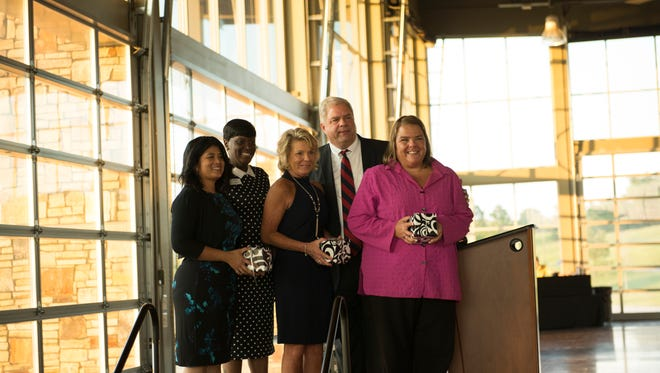 The Clarksville Area Chamber of Commerce 2016-2017 Board of Directors are presented awards.