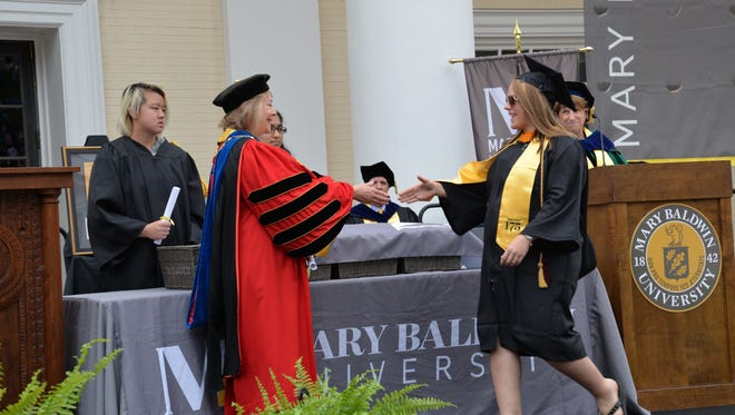 Robin Riley receives her bachelor degree for nursing during the 175th graduation ceremony on Sunday, May 21, 2017.