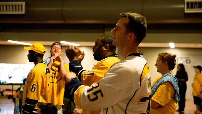 Predators fans cheer as their fourth goal of the night is scored.