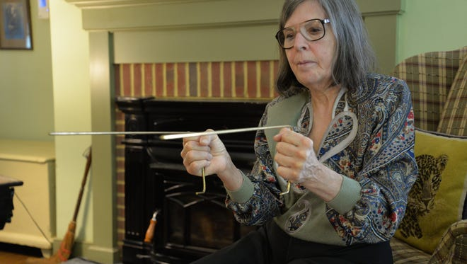 Roxanne Louise in her home in Faber, Virginia shows how dowsing rods work. She is a hypnotherapist, Reiki master and dowser.