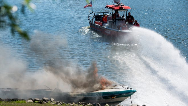 Clarksville Fire Rescue extinguish the fire from a boat in the Liberty Park Marina on June 19, 2017.