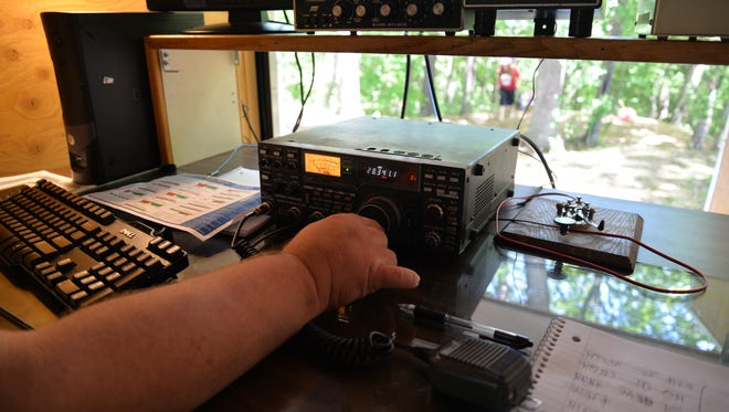 Chris Shirkey (KI4BAQ) of Mount Crawford scans the radio bands during the annual Amateur Radio Field Day with the Valley Amateur Radio Association and the Massenutten Amateur Radio Association on Sunday, June 25, 2017 near Stokesville.