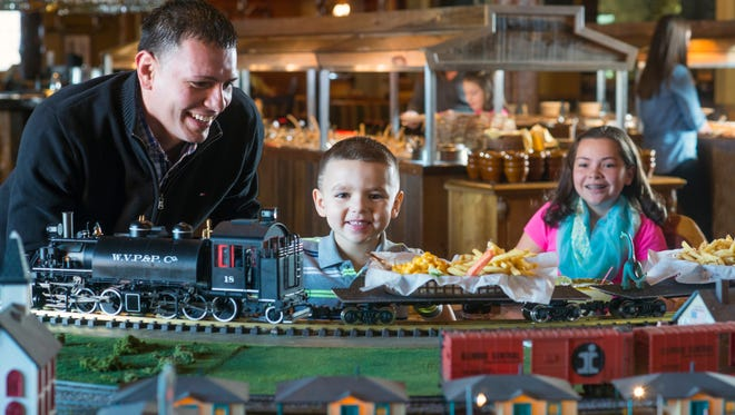 Food is delivered via a train at Buffalo Phil's in Wisconsin Dells.