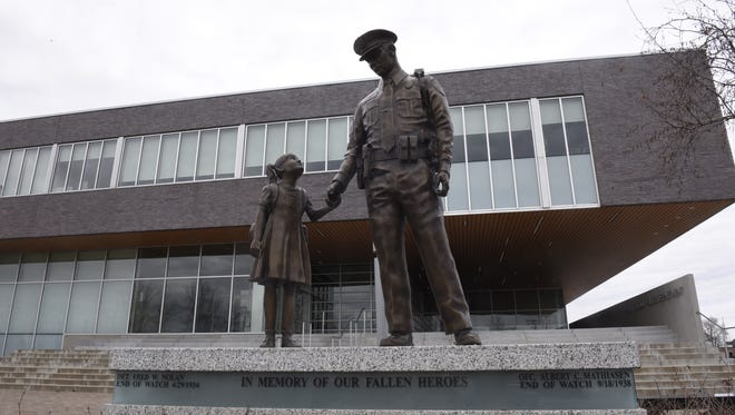 A statue outside the St. Cloud Police Department