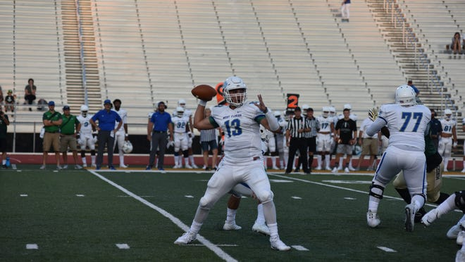 University of West Florida quarterback Mike Beaudry looks for an open receiver on Saturday against Missouri S&T in Rolla, Mo.