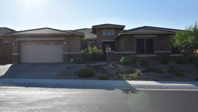 This property, a David Weekly home, is in the Goodyear master-planned community of Estrella.