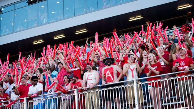 Austin Peay students cheer after their team scores their second touchdown of the night against Morehead State.