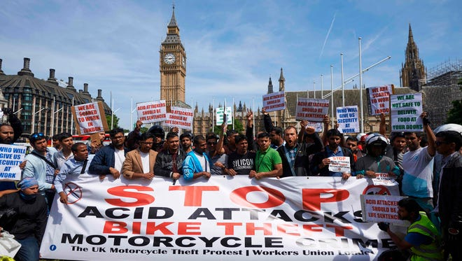 Motorcycle delivery drivers and motorcyclists take part in a demonstration in Parliament Square in central London on July 18, 2017, following a spate of acid attacks on July 13. A 16-year-old boy was charged by police investigating five linked acid attacks in London.
