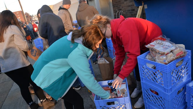 Students pick up Thanksgiving meals for the 30th annual Thanksgiving Food for Families Project on Thursday, Nov. 23, 2017.