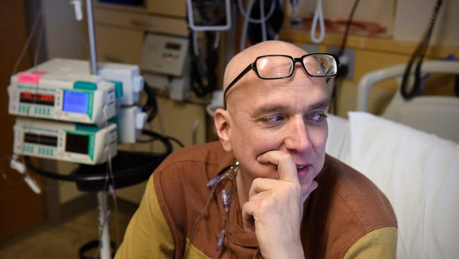 "Raine Hokan reflects on his role in the Pioneer Place on Fifth production of ""Laughing all the Way VIII: If the Fates Allow"" while receiving a chemotherapy treatment Friday, Nov. 17, at St. Cloud Hospital."
