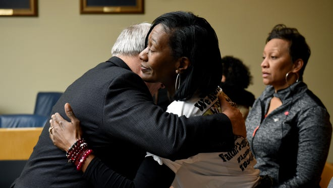 Zenobia Dobson hugs Assistant District Attorney Phil Morton after a jury convicted Christopher Bassett of first-degree murder and Kipling Colbert Jr. and Gregory Williams III of facilitation in the killing of her son Zaevion Dobson Thursday, Dec. 14, 2017.