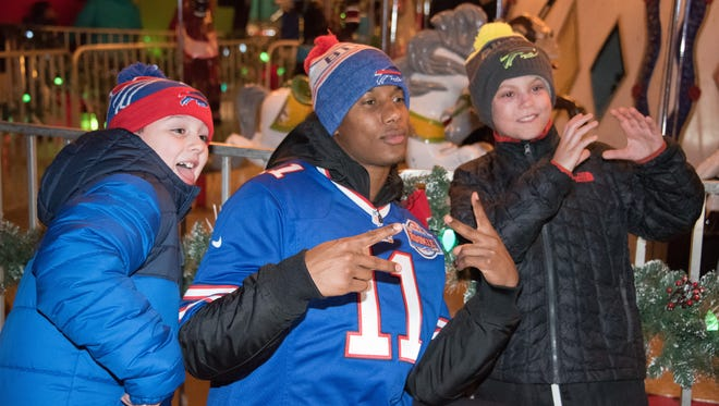 Bills rookie wide receiver Zay Jones hanging out with kids at the annual Rookie Club Holiday Party.