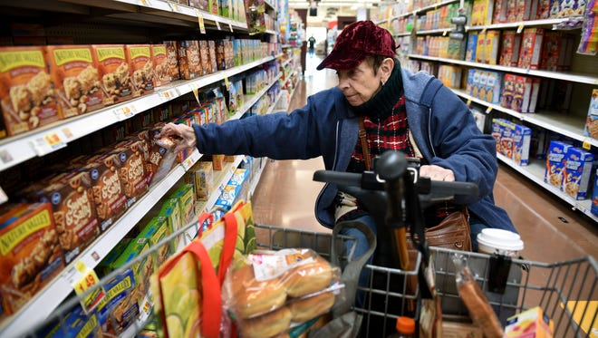 Rowena Miller shopping at the Farragut Kroger Marketplace Tuesday, Jan. 2, 2018. The Farragut Kroger and one in Alcoa will no longer be 24 hours due to lack of business.