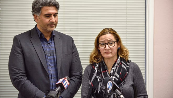 Azfar Quddus and Carolyn Rodriguez-Quddus make a statement to the media during a press conference in Anaheim on Jan 11. The California Department of Education agreed with a complaint that a lesson provided by their son's Mesa Union School teacher promoted a discriminatory bias