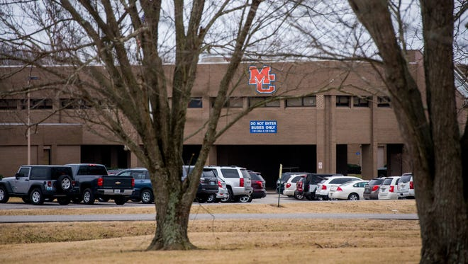 Cars parked outside of Marshall County High School following a shooting on January 23, 2018.