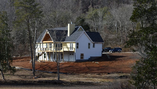 Scene in Blount County where sheriff's deputies searched for Blake Smith  on Monday, Feb. 5, 2018. Smith's car was found wrecked at a construction site in Blount County with a cinder block on the gas pedal and his phone and wallet in the car, said his aunt, Jill Brasher Williams.